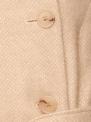 Beżowy wełniany płaszcz z wysokim kołnierzem