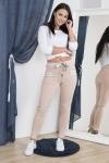 Pudrowo różowe spodnie dresowe