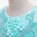 Biała sukienka komunijna zdobiona kwiatkami 3D