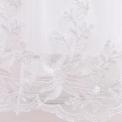 Biała suknia na komunię z dłuższym tyłem z kokardkami