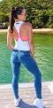 Niebieskie damskie jeansy unoszące pośladki