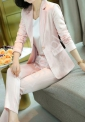 Elegancki garnitur damski z jasno różowej satyny w paski 5924